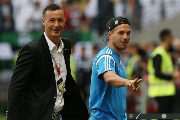 Tomasz Hajto (links) und Lukas Podolski im September 2015.